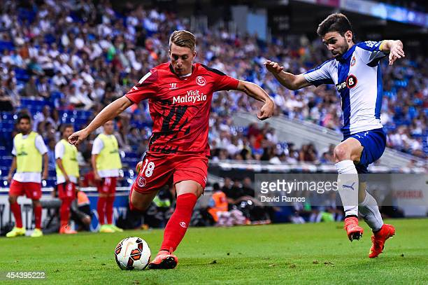 Gerard Deulofeu of Sevilla FC duels for the ball with Victor Alvarez of RCD Espanyol during the La Liga Match between RCD Espanyol and Sevilla FC at...