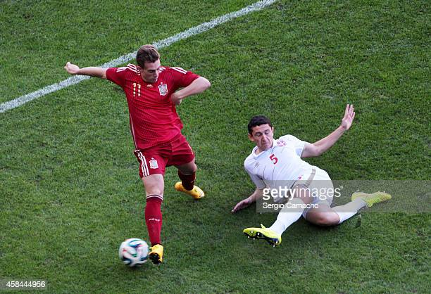 Gerard Deulofeu of Spain duels for the ball with Milos Veljkovic of Serbia during the UEFA European Under21 Championship playoff second leg match...