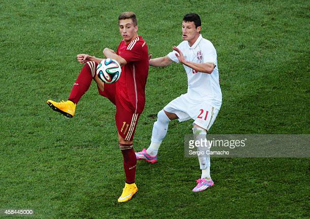 Gerard Deulofeu of Spain duels for the ball with Slavoljub Srnic of Serbia during the UEFA European Under21 Championship playoff second leg match...