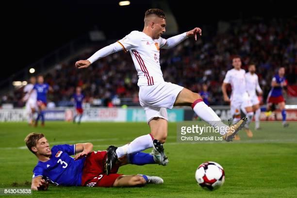 Gerard Deulofeu of Spain is challenged by Maximilian Goppel of Liechtenstein during the FIFA 2018 World Cup Qualifier between Liechtenstein and Spain...