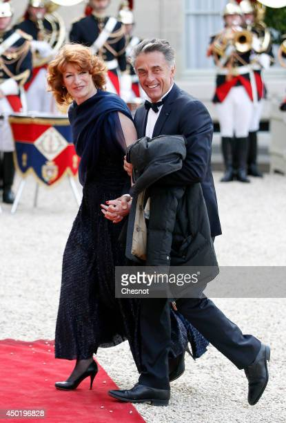 Gerard Holtz and his wife Muriel MayetteHoltz arrive at the Elysee Palace for a State dinner in honor of Queen Elizabeth II hosted by French...