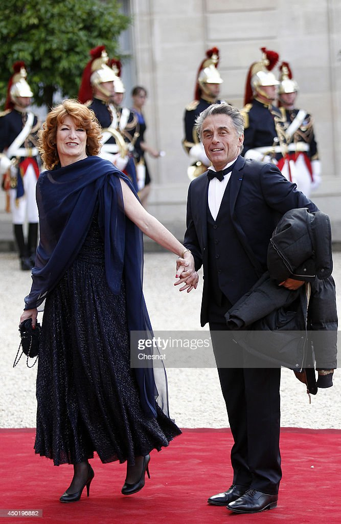 Gerard Holtz and his wife Muriel Mayette-Holtz arrive at the Elysee Palace for a State dinner in honor of Queen Elizabeth II, hosted by French President Francois Hollande as part of a three days State visit of Queen Elizabeth II after the 70th Anniversary Of The D-Day on June 6, 2014 in Paris, France.