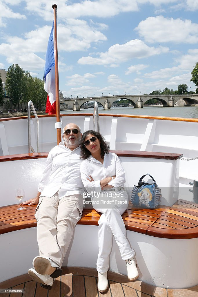 Gerard Jugnot and his companion Saida Jawad attend 'Brunch Blanc' hosted by Groupe Barriere for Sodexho with a cruise in Paris on June 30, 2013, France.