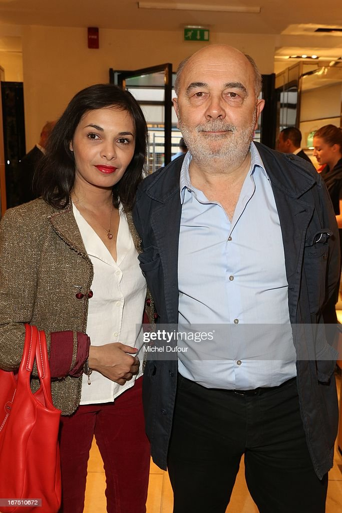Gerard Jugnot (R) and his wife attend the 'D.D. Bag Collection' Launch Cocktail at Tods Shop on April 25, 2013 in Paris, France.