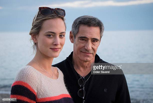 Gerard Lanvin and Nora Arnezeder pose for new movie 'Angelique' at 'Baie des Anges' beach on December 12 2013 in Nice France