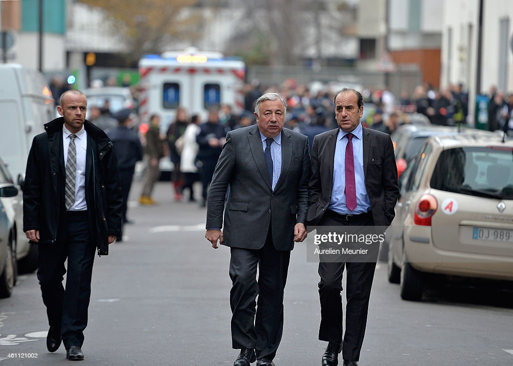 Gerard Larcher (C), President of the Senat walks out of Charlie Hebdo offices after a deadly attack on the french satirical magazine on January 7, 2015 in Paris, France. Twelve people were killed including two police officers.