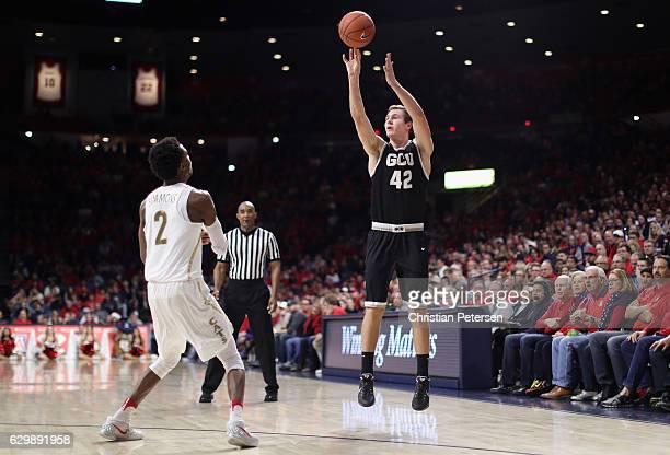 Gerard Martin of the Grand Canyon Lopes attempts a shot over Kobi Simmons of the Arizona Wildcats during the second half of the college basketball...