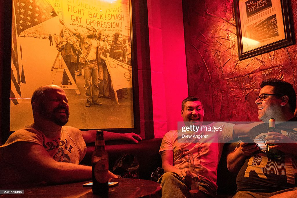 Gerard Mawn, Mawn's husband Angel Love Figueroa, and friend Angel Isaac Jimenez have drinks in a back corner of the Stonewall Inn on June 24, 2016 in New York City. President Barack Obama designated the Stonewall Inn and approximately 7.7 acres surrounding it as the first national monument dedicated 'to tell the story of the struggle for LGBT rights.' The tavern is considered the birthplace of the modern gay rights movement, where patrons fought back against police persecution in 1969.