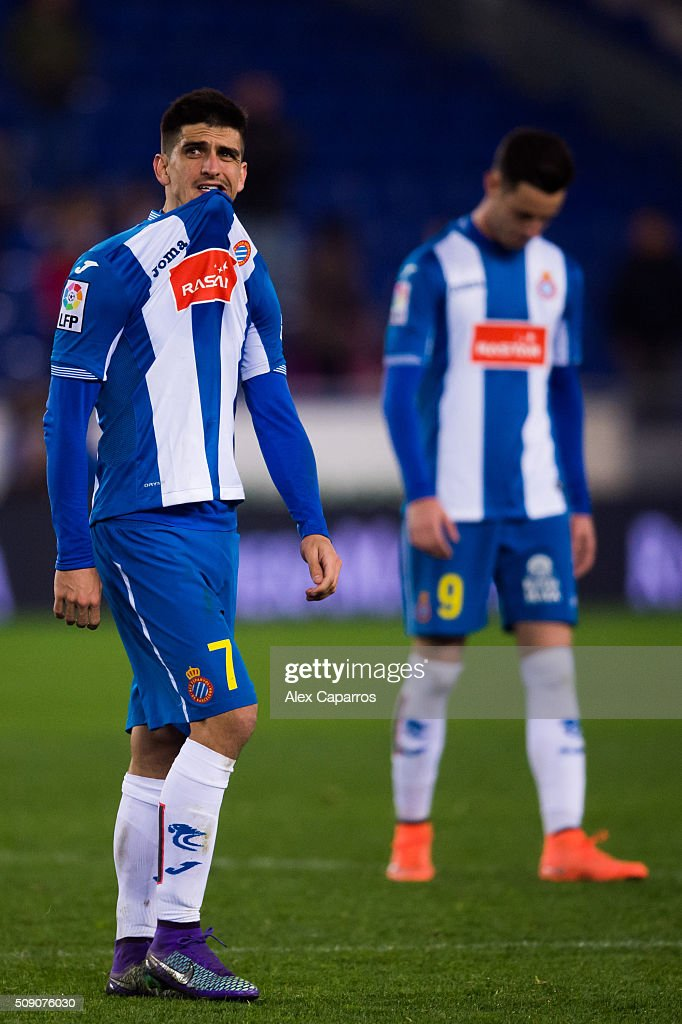 Gerard Moreno (L) and Jorge Franco 'Burgui' (R) of RCD Espanyol look dejected after the La Liga match between RCD Espanyol and Real Sociedad de Futbol at Cornella-El Prat Stadium on February 8, 2016 in Barcelona, Spain.