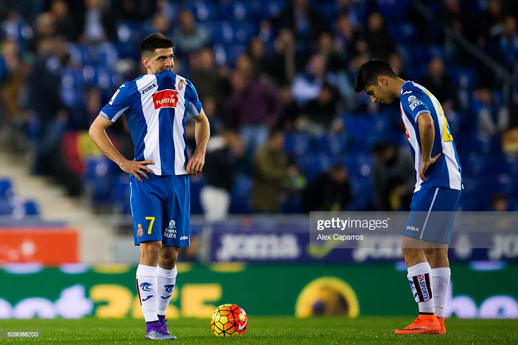 Gerard Moreno (L) and <a gi-track='captionPersonalityLinkClicked' href=/galleries/search?phrase=Marco+Asensio&family=editorial&specificpeople=13723927 ng-click='$event.stopPropagation()'>Marco Asensio</a> (R) look dejected after Carlos Vela of Real Sociedad de Futbol scored his team's second goal during the La Liga match between RCD Espanyol and Real Sociedad de Futbol at Cornella-El Prat Stadium on February 8, 2016 in Barcelona, Spain.