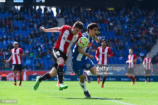 Gerard Moreno of RCD Espanyol competes for the ball with Aymeric Laporte of Athletic Club during the La Lga match between Real CD Espanyol and...
