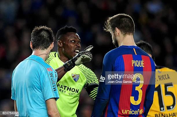 Gerard Piqué of FC Barcelona argues with Carlos Kameni of Malaga CF during the Spanish League match between FC Barcelona vs Malaga CF at Camp Nou...