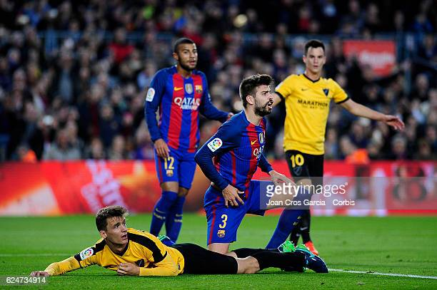 Gerard Piqué of FC Barcelona disputes with the referee during the Spanish League match between FC Barcelona vs Malaga CF at Camp Nou Stadium on...
