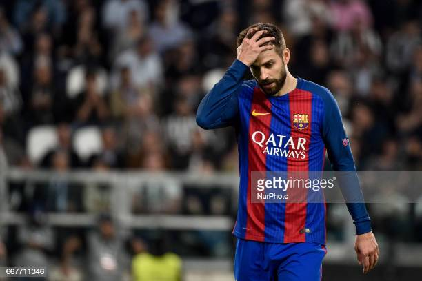 Gerard Piqué of FC Barcelona looks dejected during the UEFA Champions League quarter final match between Juventus and Barcelona at the Juventus...