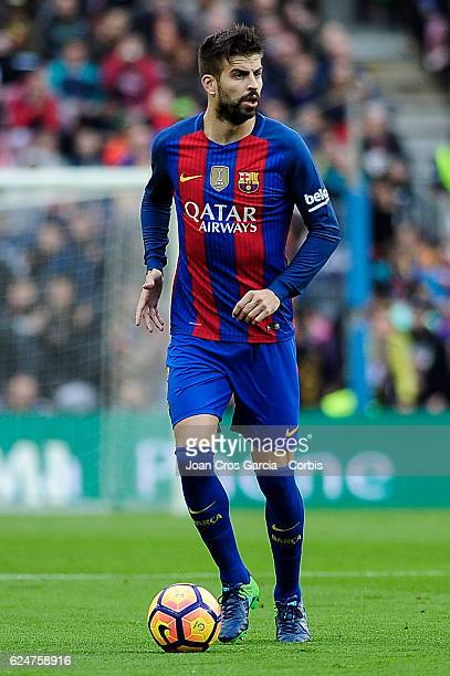 Gerard Piqué of FC Barcelona runs with the ball during the Spanish League match between FC Barcelona vs Malaga CF at Camp Nou Stadium on November 19...