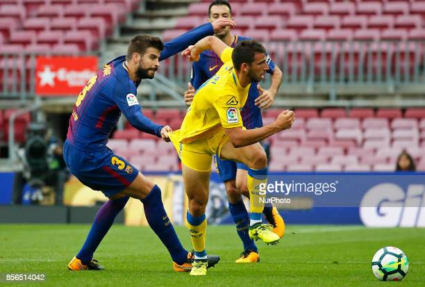 Gerard Pique and Calleri during La Liga match between FC Barcelona v UD Las Palmas that has been played behind closed doors in Barcelona on October...