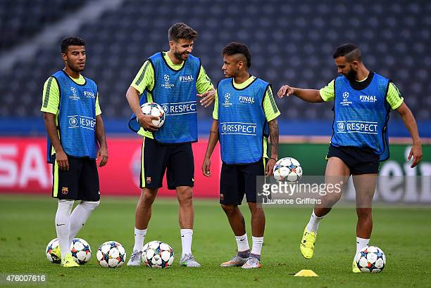 Gerard Pique and Neymar in discussion during an FC Barcelona training session on the eve of the UEFA Champions League Final match against Juventus at...