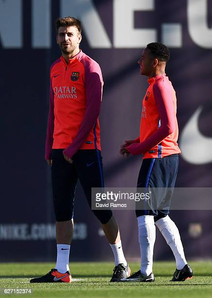 Gerard Pique and Neymar Jr of FC Barcelona talk during a training session ahead of their La Liga match between FC Barcelona and Real Madrid on...