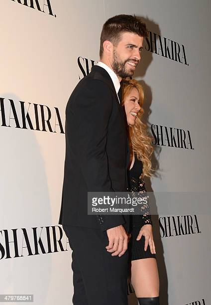 Gerard Pique and Shakira attend a photocall during a party celebrating her latest music album at the Hotel W on March 20 2014 in Barcelona Spain
