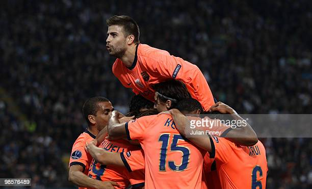 Gerard Pique celebrates with goal scorer Pedro Rodriguez of Barcelona during the UEFA Champions League Semi Final 1st Leg match between Inter Milan...