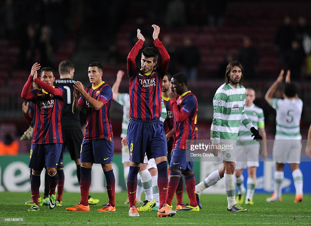 <a gi-track='captionPersonalityLinkClicked' href=/galleries/search?phrase=Gerard+Pique&family=editorial&specificpeople=227191 ng-click='$event.stopPropagation()'>Gerard Pique</a> (C) FC Barcelona applauds fans after Barcerlona beat Celtic FC 6-1 in the UEFA Champions League, Group H match between FC Barcelona and Celtic FC at the Camp Nou Stadium on December 11, 2013 in Barcelona, Spain.