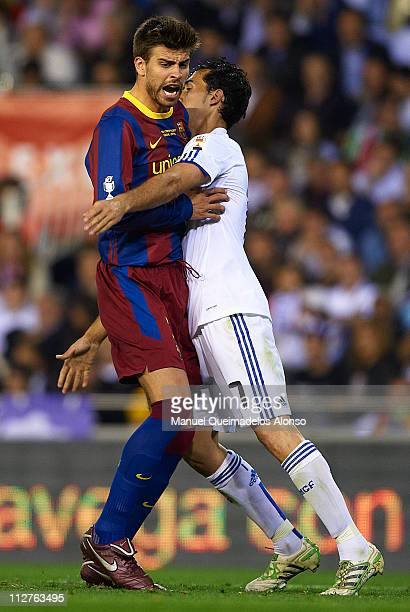 Gerard Pique of Barcelona and Alvaro Arbeola of Real Madrid fight for position during the Copa del Rey final match between Real Madrid and Barcelona...