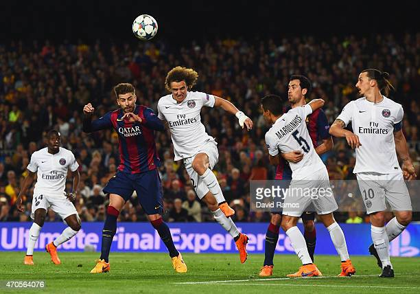 Gerard Pique of Barcelona and David Luiz of PSG challenge for a header during the UEFA Champions League Quarter Final second leg match between FC...