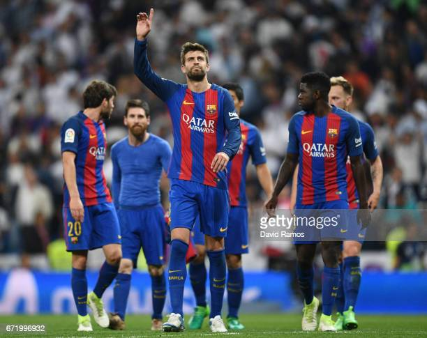Gerard Pique of Barcelona and team mates celebrate victory after the La Liga match between Real Madrid CF and FC Barcelona at Estadio Bernabeu on...