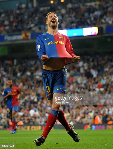 Gerard Pique of Barcelona celebrates after scoring Barcelona's sixth goal during the La Liga match between Real Madrid and Barcelona at the Santiago...