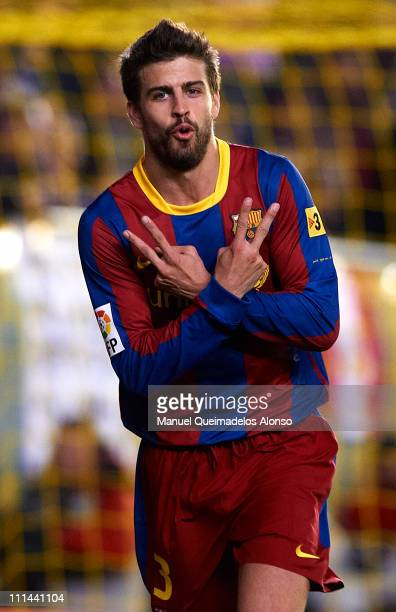 Gerard Pique of Barcelona celebrates after scoring during the La Liga match between Villarreal and Barcelona at El Madrigal on April 2 2011 in...