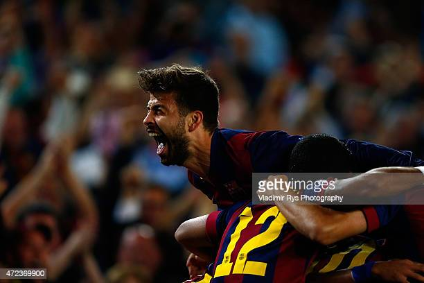 Gerard Pique of Barcelona celebrates his team's third goal scored by Neymar during the first leg of UEFA Champions League semifinal match between FC...