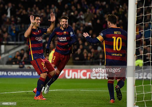 Gerard Pique of Barcelona celebrates scoring his teams fourth goal with Luis Suarez and Lionel Messi during the UEFA Champions League Group E match...