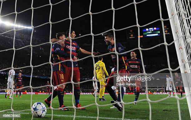 Gerard Pique of Barcelona celebrates scoring his teams fourth goal with Luis Suarez Lionel Messi and Neymar during the UEFA Champions League Group E...