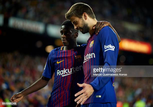 Gerard Pique of Barcelona celebrates scoring his team's fourth goal with his teammate Ousmane Dembele during the La Liga match between Barcelona and...