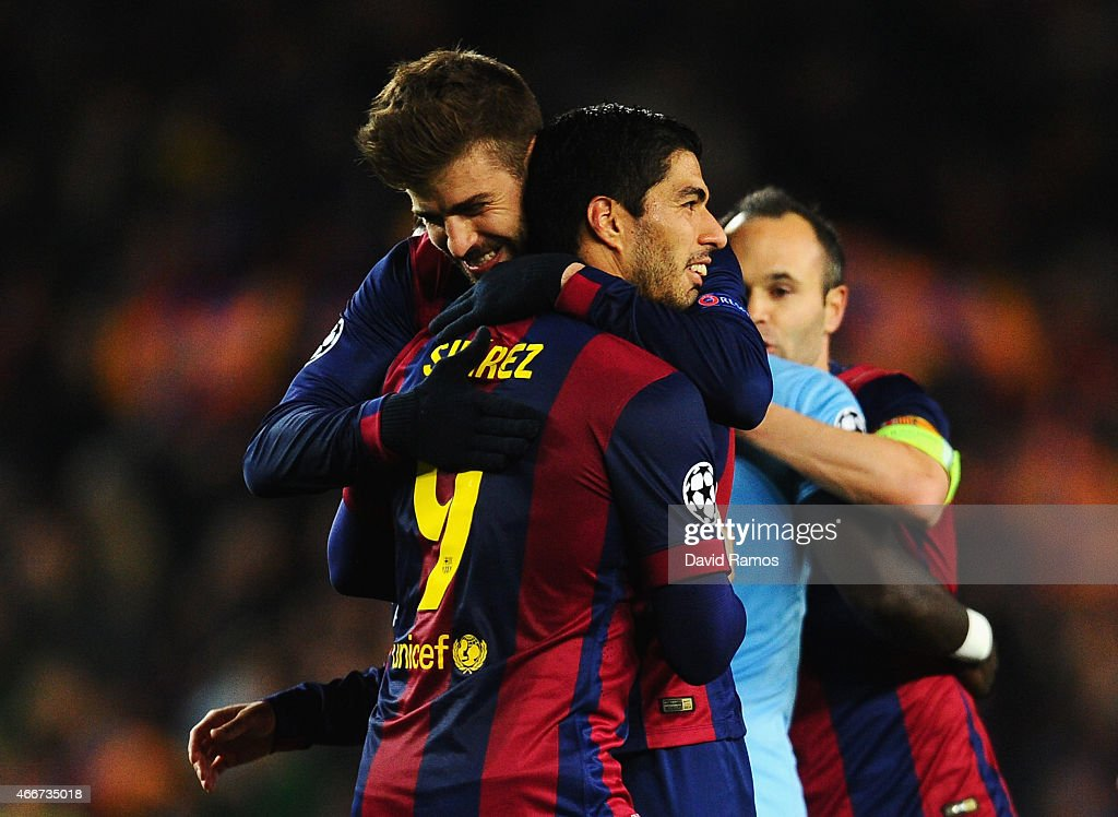 Gerard Pique of Barcelona celebrates victory with Luis Suarez of Barcelona after the UEFA Champions League Round of 16 second leg match between Barcelona and Manchester City at Camp Nou on March 18, 2015 in Barcelona, Spain.