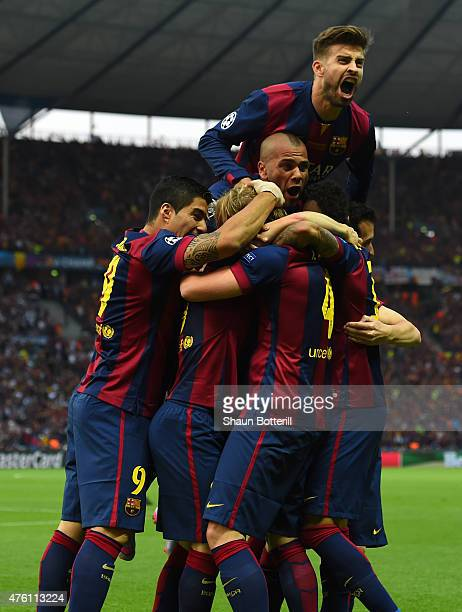 Gerard Pique of Barcelona celebrates with team mates after the goal scored by Ivan Rakitic during the UEFA Champions League Final between Juventus...