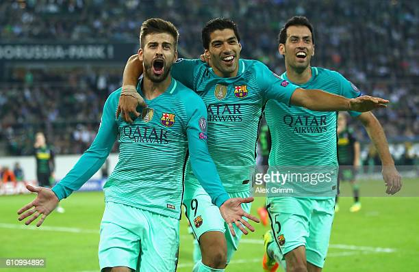 Gerard Pique of Barcelona celebrates with teammates Luis Suarez and Sergio Busquets after scoring his teams second goal during the UEFA Champions...