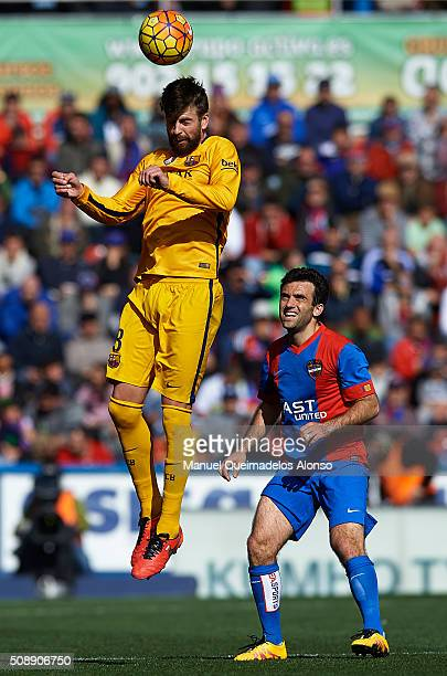 Gerard Pique of Barcelona challenges by Giusseppe Rossi of Levante during the La Liga match between Levante UD and FC Barcelona at Ciutat de Valencia...