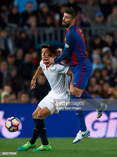 Gerard Pique of Barcelona competes for the ball with Joaquin Correa of Sevilla during the La Liga match between FC Barcelona and Sevilla FC at Camp...