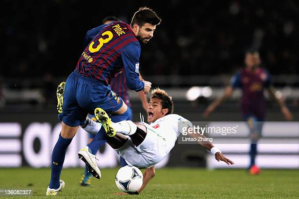 Gerard Pique of Barcelona is challenges Neymar of Santos during the FIFA Club World Cup Final match between Santosl and Barcelona at the Yokohama...