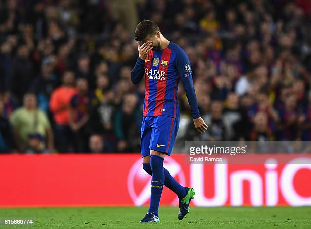 Gerard Pique of Barcelona leaves the pitch following an injury during the UEFA Champions League group C match between FC Barcelona and Manchester...