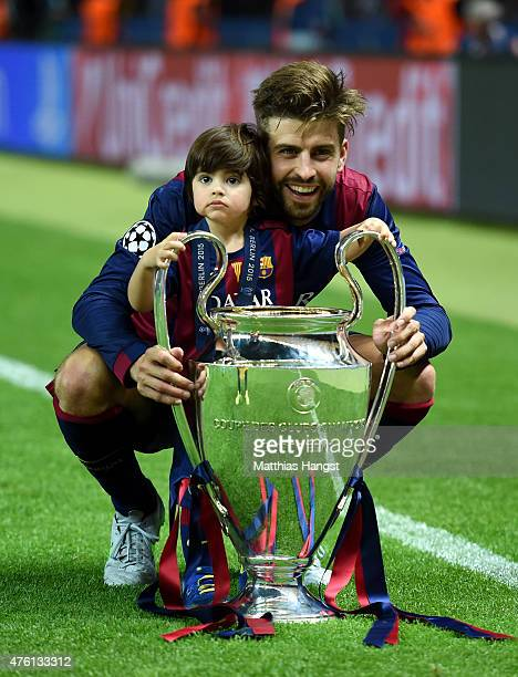 Gerard Pique of Barcelona poses with his son Milan and the trophy after the UEFA Champions League Final between Juventus and FC Barcelona at...
