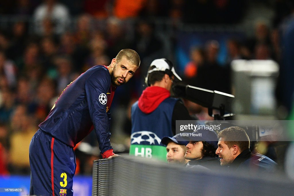 <a gi-track='captionPersonalityLinkClicked' href=/galleries/search?phrase=Gerard+Pique&family=editorial&specificpeople=227191 ng-click='$event.stopPropagation()'>Gerard Pique</a> of Barcelona reacts after scoring an own goal during the UEFA Champions League semi final second leg match between Barcelona and FC Bayern Muenchen at Nou Camp on May 1, 2013 in Barcelona, Spain.