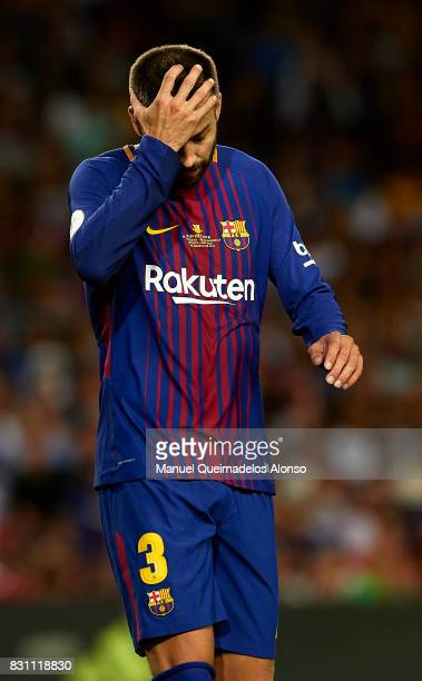 Gerard Pique of Barcelona reacts during the Supercopa de Espana Supercopa Final 1st Leg match between FC Barcelona and Real Madrid at Camp Nou on...