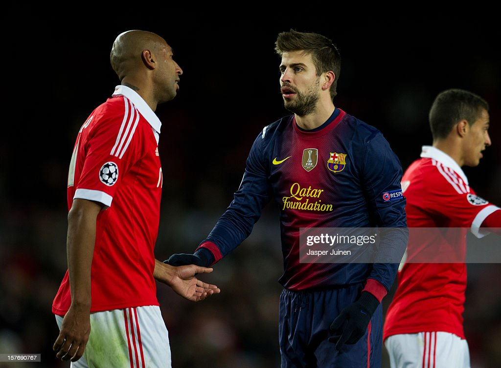 <a gi-track='captionPersonalityLinkClicked' href=/galleries/search?phrase=Gerard+Pique&family=editorial&specificpeople=227191 ng-click='$event.stopPropagation()'>Gerard Pique</a> (R) of Barcelona reacts to <a gi-track='captionPersonalityLinkClicked' href=/galleries/search?phrase=Luisao&family=editorial&specificpeople=490899 ng-click='$event.stopPropagation()'>Luisao</a> of SL Benfica after a foule on him during the UEFA Champions League Group G match between FC Barcelona and SL Benfica at the Camp Nou stadium on December 5, 2012 in Barcelona, Spain.