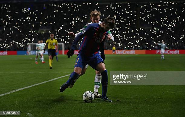 Gerard Pique of Barcelona vies with Stuart Armstrong of Celtic during the UEFA Champions League match between Celtic FC and FC Barcelona at Celtic...