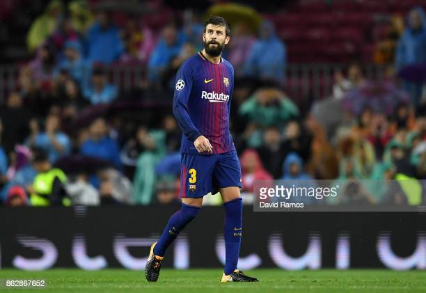 Gerard Pique of Barcelona walks off the pitch after being shown a red card during the UEFA Champions League group D match between FC Barcelona and...