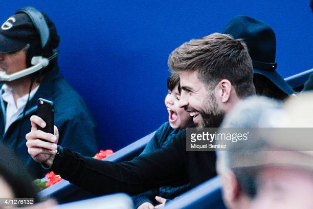 Gerard Pique of FC Barcelona and Milan Pique attend with a selfie the final between Kei Nishikori of Japan against Pablo Andujar of Spain during the...