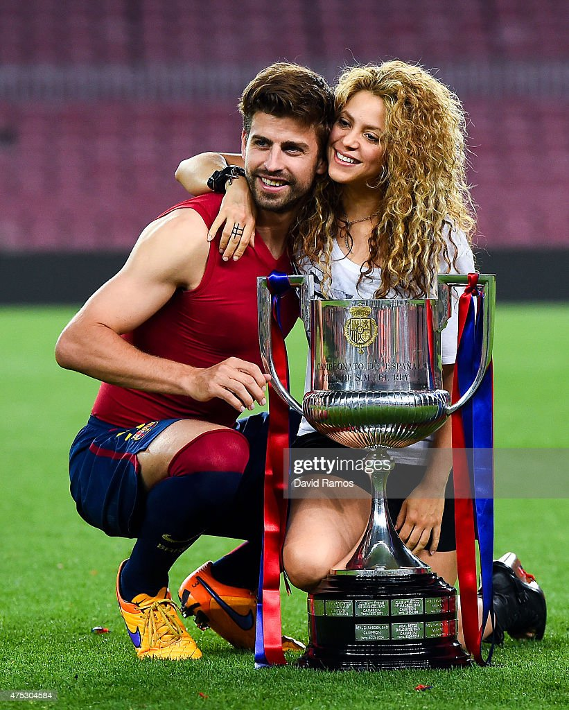<a gi-track='captionPersonalityLinkClicked' href=/galleries/search?phrase=Gerard+Pique&family=editorial&specificpeople=227191 ng-click='$event.stopPropagation()'>Gerard Pique</a> of FC Barcelona and <a gi-track='captionPersonalityLinkClicked' href=/galleries/search?phrase=Shakira&family=editorial&specificpeople=160650 ng-click='$event.stopPropagation()'>Shakira</a> pose with the trophy after FC Barcelona won the Copa del Rey Final match against Athletic Club at Camp Nou on May 30, 2015 in Barcelona, Spain.