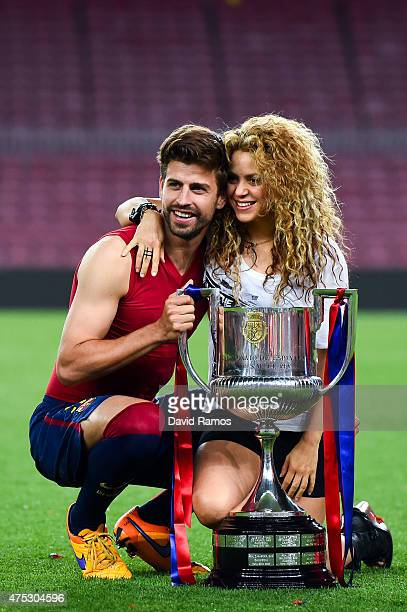 Gerard Pique of FC Barcelona and Shakira pose with the trophy after FC Barcelona won the Copa del Rey Final match against Athletic Club at Camp Nou...